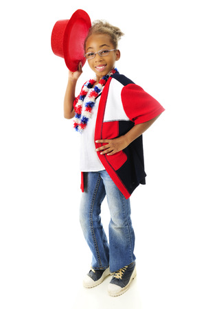 A happy elementary girl tipping her red top hat while wearing her red, white and blue.  On a white background. photo