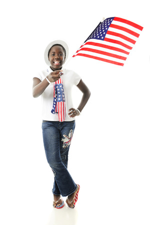 A happy tween girl waving an American flag while showing off her stars and stripes.  On a white background. photo