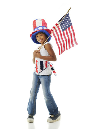 sam: A young elementary girl happily showing off her national colors including the American flag.  On a white background.