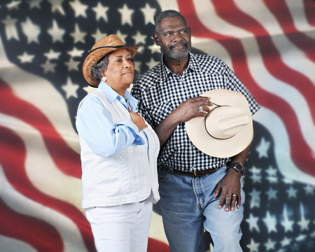 A mature western couple giving tribute to their country   They photo