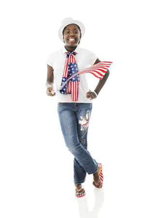 A pretty tween girl proudling wearing her countrys colors while waving an American flag.  On a white background. photo