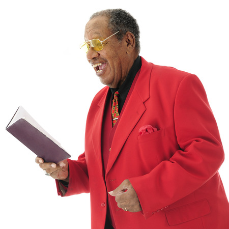 hymnal: Close-up image of a dressed-up senior African American singing from a hymnal.  On a white background.