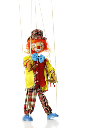 A clown marionette puppet isolated on white. photo
