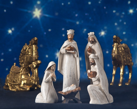 A star-lit nativity scne composed of the three wisemen, their camels, Mary and baby Jesus.   photo