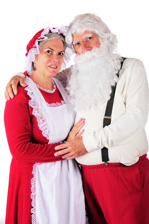 mrs santa: Three-quarter length portrait of Mr. and Mrs. Santa in their at-home attire.  On a white background. Stock Photo