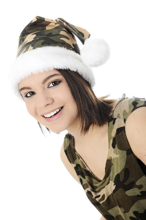 camoflauge: Close-up image of a beautiful teen girl dressed in a sleeveles camoflauge shirt and Santa-style hat.  On a white background.