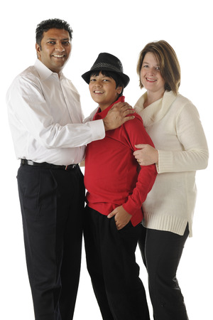 A bircial family of three -- an Asian Indian dad, caucasian mom and their handsome preteen son.  On a white background. photo