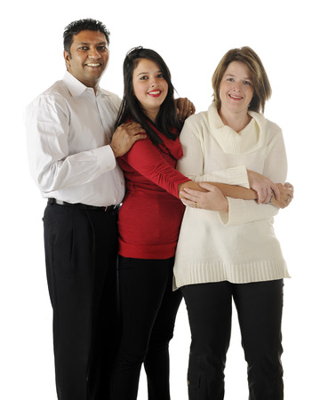 A biracial family portrait of three -- an Asian Indian dad, a caucasian mom and their teenage daughter.  On a white background. photo