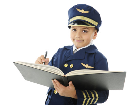 log book: Close-up image of a handsome elementary airline pilot signing the pilots log book.  On a white background. Stock Photo