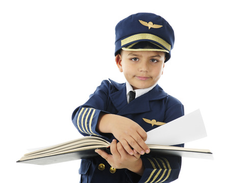 log book: A handsome elementary pilot turning the pages of a pilots log book.  On a white background.