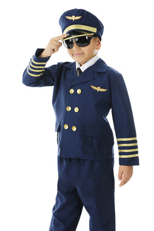 A handsome elementary airline pilot giving a two-finger salute.  On a white background.