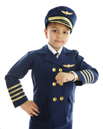 airline pilot: A handsome elementary airline pilot looking worried after checking his watch.  On a white background.