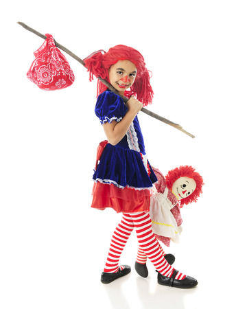 rick rack: An adorable elementary rag doll running away with her toy rag doll.  On a white background.