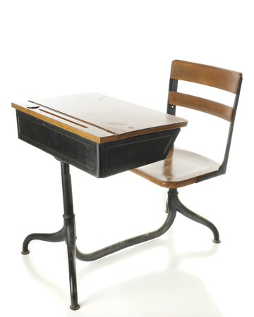 child's: A childs antique, flip-top wood and metal school desk.  On a white background. Stock Photo