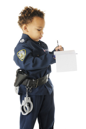 traffic cop: An adorable preschool traffic cop in uniform writing a ticken.  On a white background.