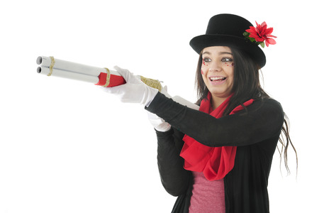A pretty teen, her face adorned with rhinestones and sparkly hearts, delightedly aiming a red, white and gold rifle to snag her prey.  On a white background. photo