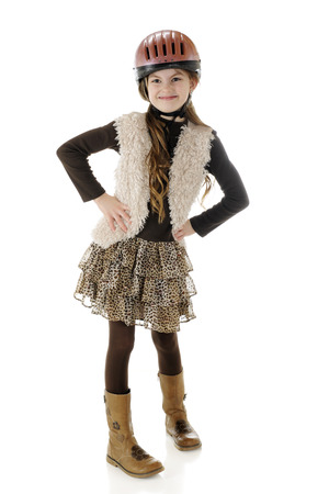 riding helmet: A full length portrait of a happy young horseback rider looking sassy in her riding helmet and boots.  On a white background.