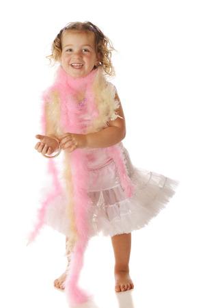 boas: A beautiful preschool girl in boas, braceletts and a petticoat.  Isolated on white. Stock Photo
