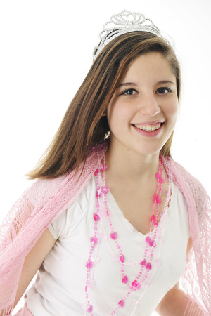 lacey: A beautiful teen girl happily wearing a crown, lacey pink shawl and a silver crown.  On a white background. Stock Photo