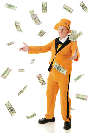 lapels: A flamboyant senior man wearing an orange tuxedo and hat, tossing or catching falling100, 50 and 20 dollar bills.  On a white background.