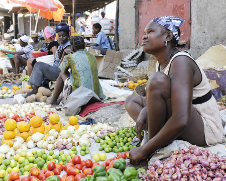 Women selling fruits and veggies along the street in St. Marc, Haiti. Editorial