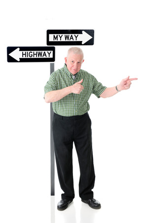 thumbsup: A senior adult man standing before a My Way and the Highway signs.  Hes happily pointing in the My Way direction while giving a thumbs-up gesture.  On a white background. Stock Photo