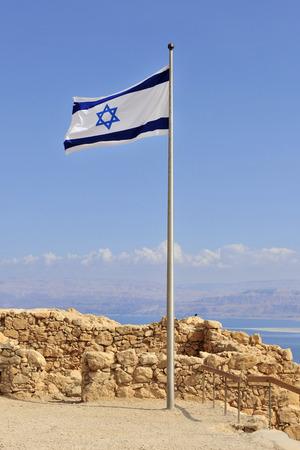 masada: The Jewish flag in the breeze atop Masada. Israel, overlooking the Dead Sea.