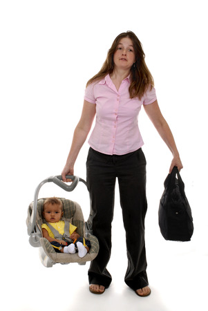 tote: Mom waling with her diaper bag and baby in a tote.  On a white background. Stock Photo