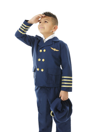 pilot light: A handsome elementary airline pilot watching the sky with he hand shielding his eyes from the light.  On a white background