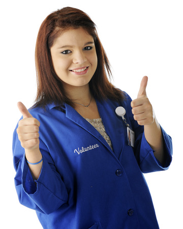 two thumbs up: A beautiful teen volunteer happily holding two thumbs up.  On a white background. Stock Photo