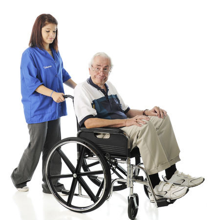 wheel chair: A young teen volunteer pushing an elderly man in his wheel chair.  On a white background. Stock Photo
