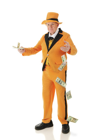 lapels: A flamboyant senior adult in a bright orange tuxedo and hat, carelessly offering money and dropping big bills.  On a white background.