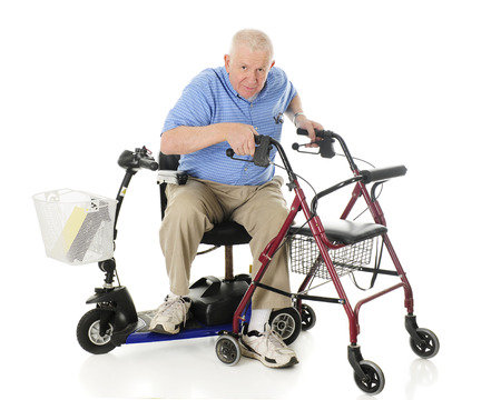 A senior man transferring from his electric scooter to his wheeling walker.  On a white background. Stockfoto