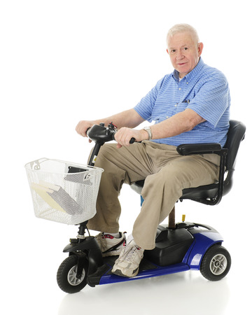 A senior man smiling at the viewer as he's ready to drive away on his scooter.  On a white background
