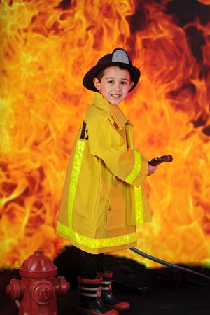 fireman: An adorable preschool fireman ready to douse ragingflames with his hose.