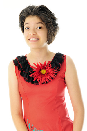mexican dress: A beautiful young Hispanic teen happily wearing a red  mexican dress with black neck ruffles and a giant red flower.  On a white background.
