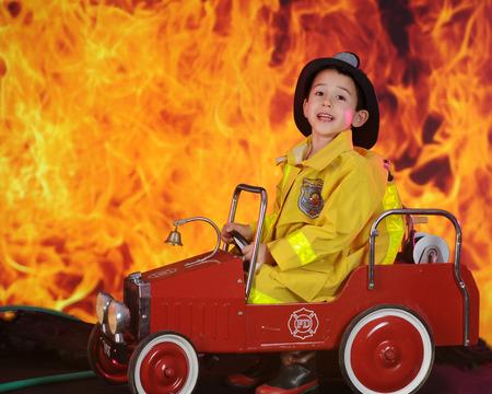 fireman: A preschool fireman calling for reinforcements for the huge blaze behind his vintage toy fire truck.