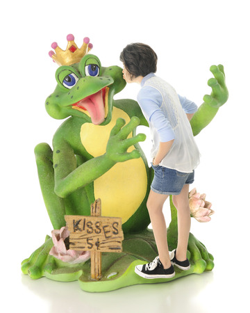 five cents: A young teen girl kissing a delighted frog prince.  The price ...only five cents!  On a white background.