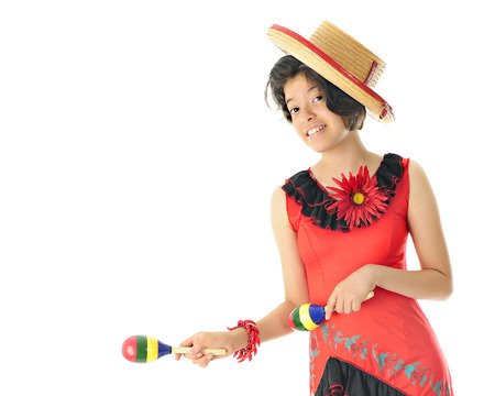 mexican dress: A young teen girl dancing in her red and black Mexican dress and hat, happily accompanying the beat with colorful maracas.  On a white background with space on the left for your text.
