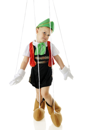glove puppet: An adorable preschool Pinocchio marionette in a standing pose, strings and all.  On a white background. Stock Photo
