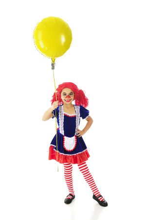 panty hose: An adorable elementary rag doll happily holding a big, yellow smiley balloon.  On a white background.