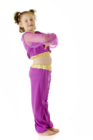 An elementary-aged genie standing, looking at viewer with arms crossed geni e style.  On a white background. photo