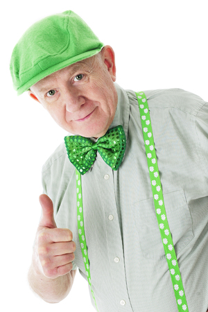 sparkly: A senior Irishman in a green hat, suspenders and sparkly bowtie giving a happy thumbs up.  On a white background.