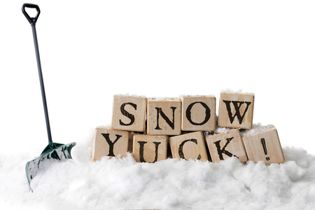 Large, rustic alphabet blocks in snow arranged to spell out SNOW YUCK!  A green shovel is stuck in the snow nearby.  On a white background.