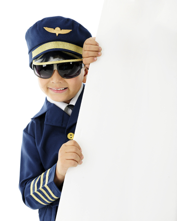 airline pilot: A handsome elementary airline pilot happily holding a sign, left blank for your text.  On a white background. Stock Photo