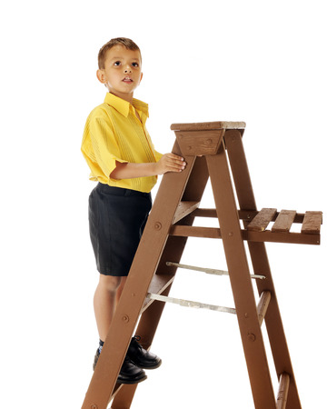 figure out: A handsome preschooler on a ladder trying to figure out how to get higher at another location.  Isolated on white.