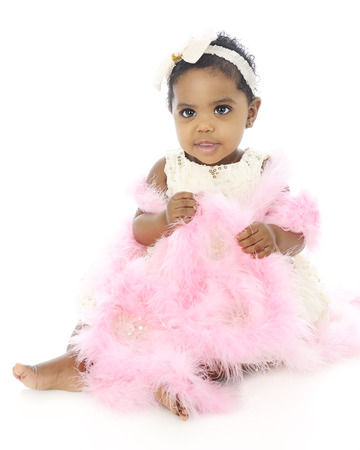 dressed up: A beautiful baby girl all dressed up in white covered with a pink boa.  On a white background. Stock Photo