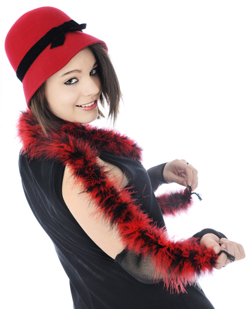 black boa: A beutiful teen flapper looking shyly back in her red and black Roaring 20s outfit.  On a white background.