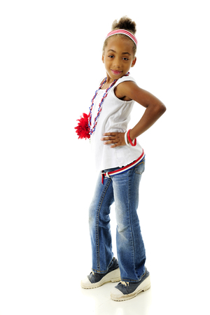 sassy: Full length image of a sassy elementary girl proudly wearing her red, white and blue.  On a white background.