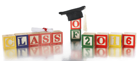 alphabet blocks: Colorful alphabet blocks arranged to spell Class of 2016.  A rolled diploma and mortarboard with tassel rest on top.  On a white background.